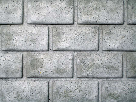 Concrete fence with brick pattern