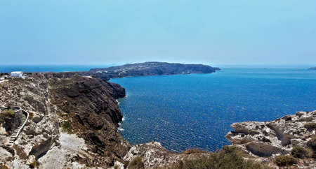 charming island in the Aegean Sea and the Ionian mediterranean rocky beaches of Santorini photo