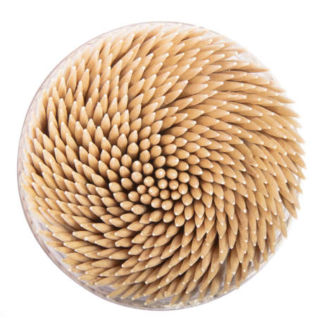 toothpicks in a round box, top view, isolated on white background