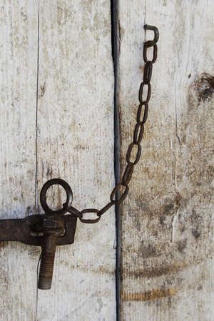 Old rusty lock on a wooden door