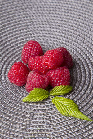 raspberries on a gray background photo