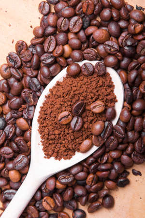 instant coffee on coffee beans background photo