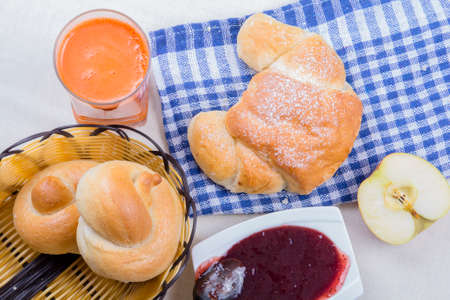croissant, juice, bagels and jam, breakfast ingredients photo
