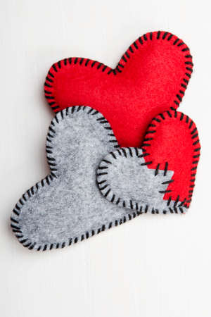 felt heart on a white wooden , valentines composition Stock Photo