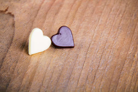 chocolate hearts on a wooden table - valentines composition Stock Photo