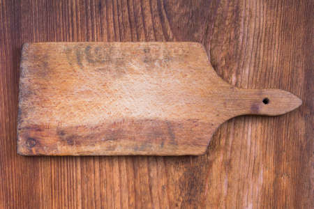 trencher: old wooden cutting board on a wooden background