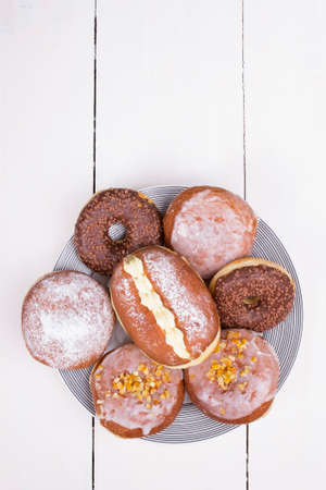 donuts on the platter, top view, white background