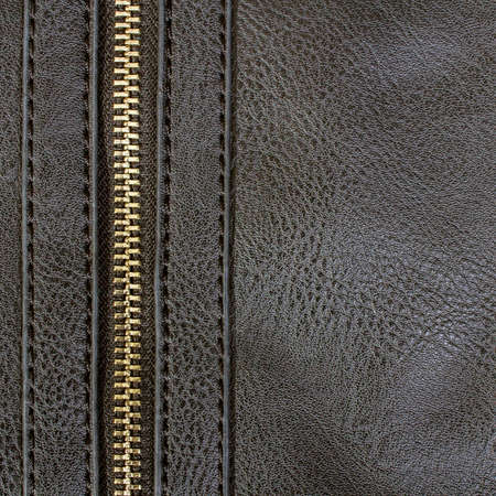 dark artificial leather with zipper for background photo