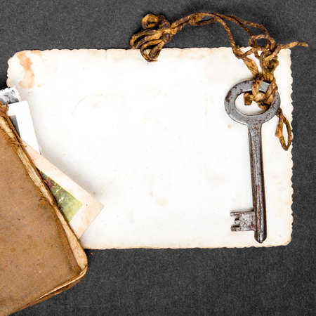 Rusty key, old book and empty photography as a memory metaphor photo