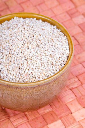 groats: barley groats in a brown bowl