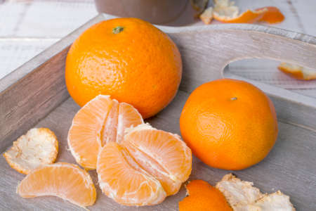 fresh tangerines in a wooden box Stock Photo