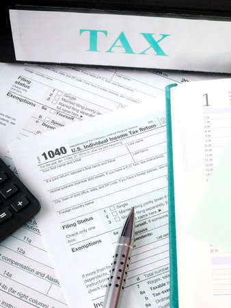 Close Up Us Individual Tax Form 1040 With Calculator And Pen