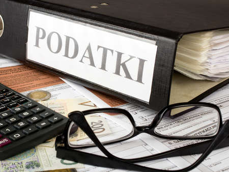 Filling in polish individual income tax form PIT with money and pen Stock Photo