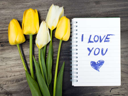 i pad: tulip bouquet and notepad with words I love you