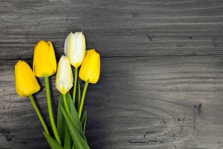 tulip bouquet on dark wooden background photo