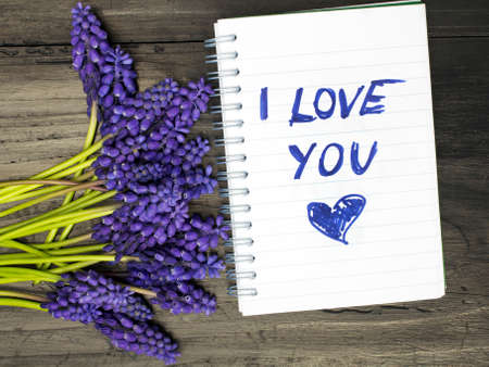 i pad: Muscari bouquet and notepad with words I love you Stock Photo