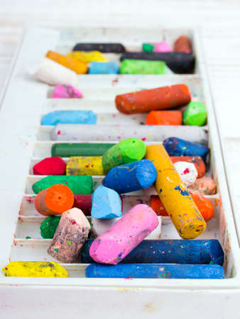 coloured pencils: oil pastels in a box