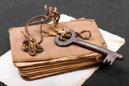 Rusty key old book and empty photography as a metaphor knowledge Stock Photo