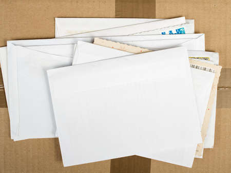 stack of business cards: a pile of letters and postal parcel Stock Photo