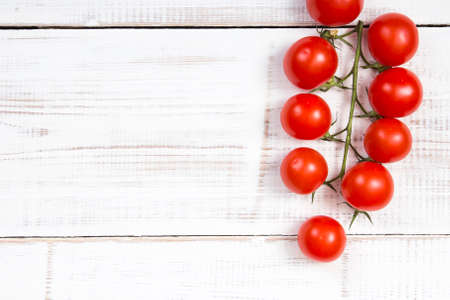 cherry tomatoes on white wooden background Stock Photo