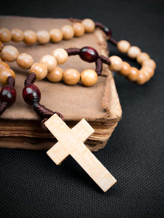 prayer book: rosary and prayer book on a dark background