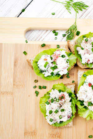 chives: sandwiches with cottage cheese chives and salad. Stock Photo