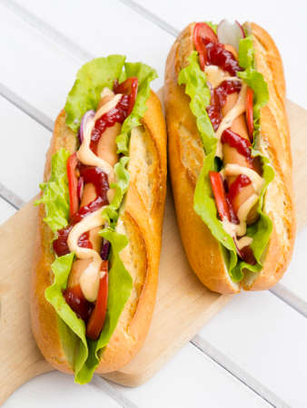 hot dogs: hot dogs on a wooden table Stock Photo