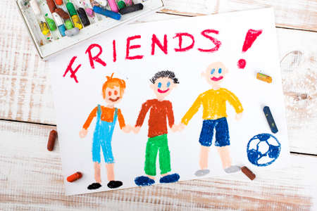 youthful: drawing of friends playing football