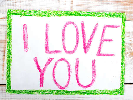 i kids: words  I LOVE YOU written in crayon on paper Stock Photo