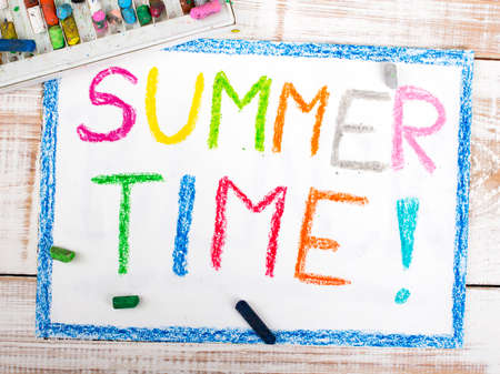 summer time: words SUMMER TIME written in crayon on paper