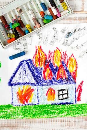 burning paper: colorful drawing: burning house Stock Photo