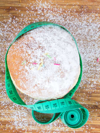 powdered: Tape measure and donuts with powdered sugar