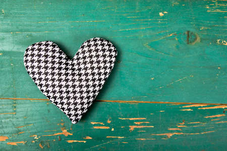 houndstooth: houndstooth heart on a green background