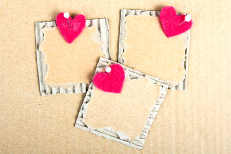plaque: cardboard plaque and felt heart - Valentine background Stock Photo
