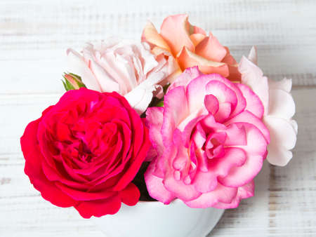 bouquet of roses on a wooden background Stock Photo
