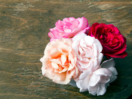 womans: bouquet of roses on a wooden background Stock Photo