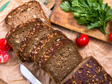 wholemeal bread with sunflower seeds and delicious fresh vegetables Stock Photo