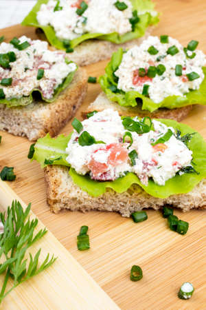 chives: sandwiches with cottage cheese, chives and salad. Stock Photo