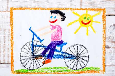 drawing boy: colorful drawing: boy riding bike