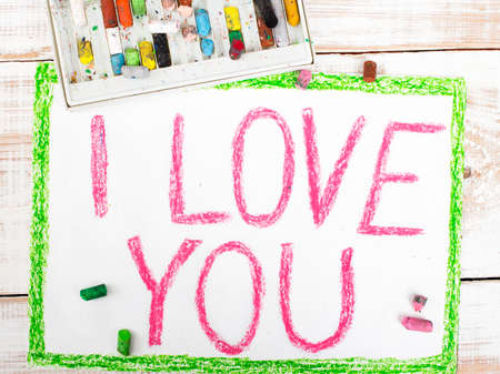 love picture: words  I LOVE YOU written in crayon on paper Stock Photo