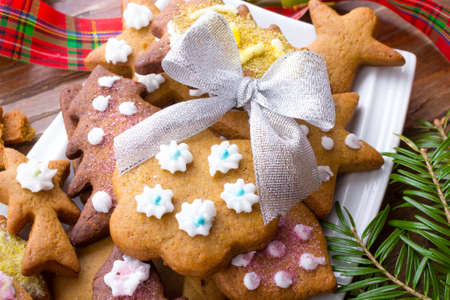 gingerbread cookies: Colorful Christmas gingerbread cookies on wooden background