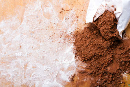 cocoa powder on wooden background