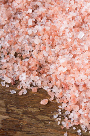 himalayan salt: Closeup of a Himalayan salt on wooden background - shallow depth of field Stock Photo