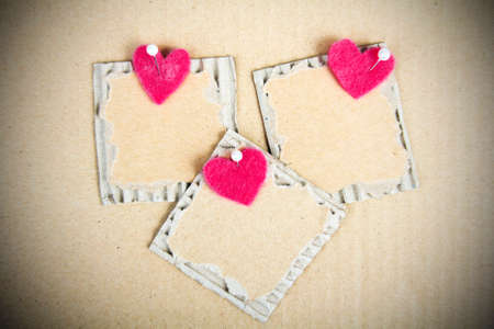 plaque: cardboard plaque and felt heart - Valentine background Stock Photo