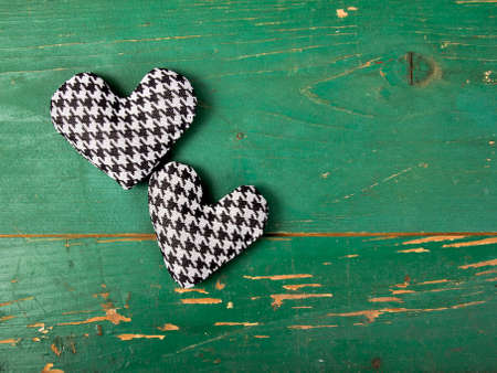 houndstooth: houndstooth hearts on a green background