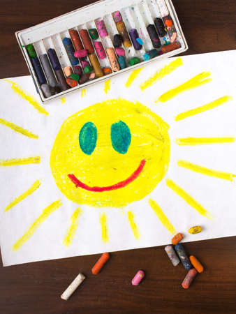 'face painting': colorful drawing: sun with a happy face Stock Photo
