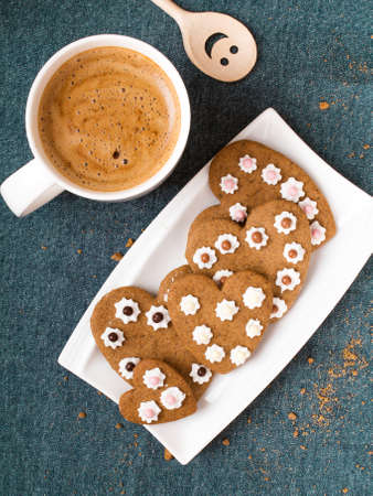 shaped: Cup of coffee and heart shaped cookies
