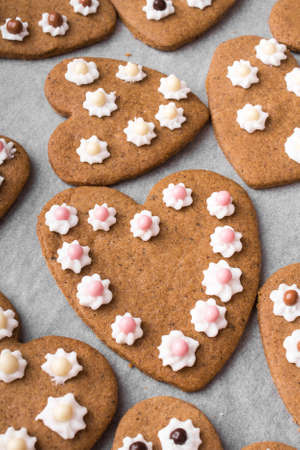 shaped: Heart shaped cookies on baking paper background