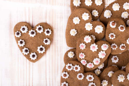 shaped: Heart shaped cookies on white wooden background