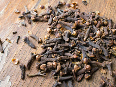 cloves: cloves on a wooden background